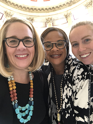 Molly with colleagues Nicole Collier and Kelsey Freeman, welcoming the new Congress in 2019.