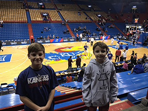 Molly's twin boys, Aidan and Conor, at a Jayhawks game.