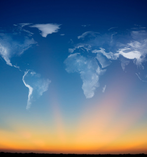 sunrise with clouds shaped like the countries of the world